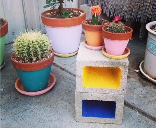 The cinder blocks can play the role of flower stands.